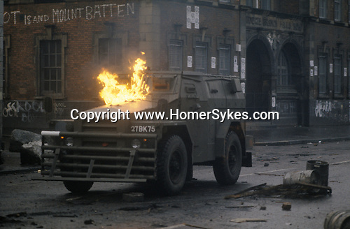Northern Ireland The Troubles. 1980s. 1981 British army armoured vechicle comes under petrol bomb attack patroling streets in Catholic area of Belfast UK. The vechicle, an armoured personnel carrier,  a  Humber 1 Ton (Pig).