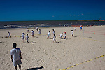 Montevideo, Uruguay - Children Play soccer on the beach of the river of Plata in Montevideo