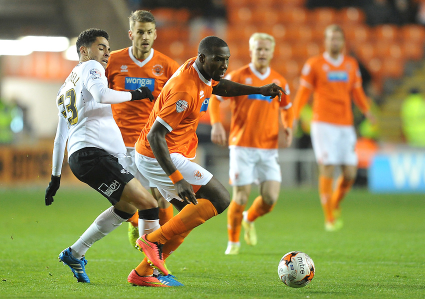 Blackpool's Joel Dielna battles past Derby County's Omar Mascarell<br /> <br /> Photographer Dave Howarth/CameraSport<br /> <br /> Football - The Football League Sky Bet Championship - Blackpool v Derby County - Tuesday 21st October 2014 - Bloomfield Road - Blackpool<br /> <br /> &copy; CameraSport - 43 Linden Ave. Countesthorpe. Leicester. England. LE8 5PG - Tel: +44 (0) 116 277 4147 - admin@camerasport.com - www.camerasport.com