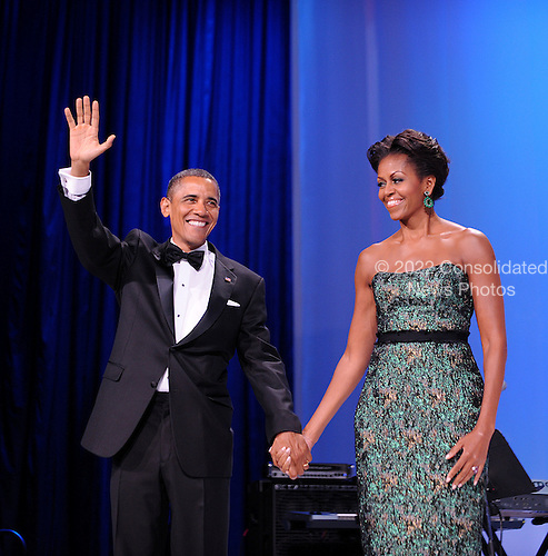 United States President Barack Obama and First Lady Michelle Obama wave during the Congressional Hispanic Caucus Institute's 34th Annual Awards Gala at the Washington Convention Center in Washington, DC, September 14, 2011..Credit: Olivier Douliery / Pool via CNP