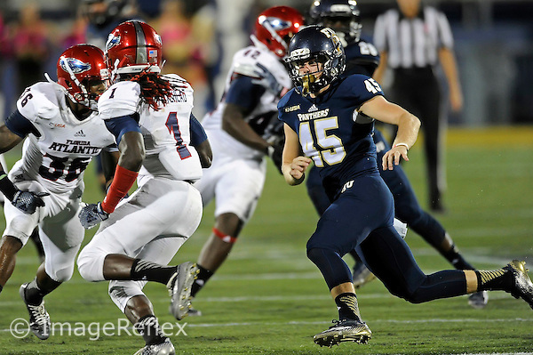 2 October 2014:  FIU long snapper Sam Medlock (45) pursues Florida Atlantic wide receiver Lucky Whitehead (1) during a kick return in the second half as the FIU Golden Panthers defeated the Florida Atlantic Owls, 38-10, to win the annual Shula Bowl Game, at FIU Stadium in Miami, Florida.
