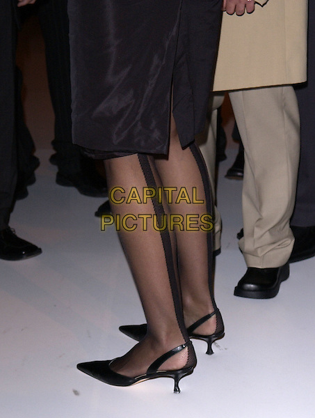 """JERRY HALL'S LEGS.Filming fashion show for """"Kept"""", to be broadcast on VH1 in May. Jerry Hall was asked to make-over American models with Vivienne Westwood Clothes in order to anglisise them!  London College of Fashion, January 21st 2005..feet tights stilettoes cloe up detail.Ref: DH.www.capitalpictures.com.sales@capitalpictures.com.©David Hitchens/Capital Pictures ."""