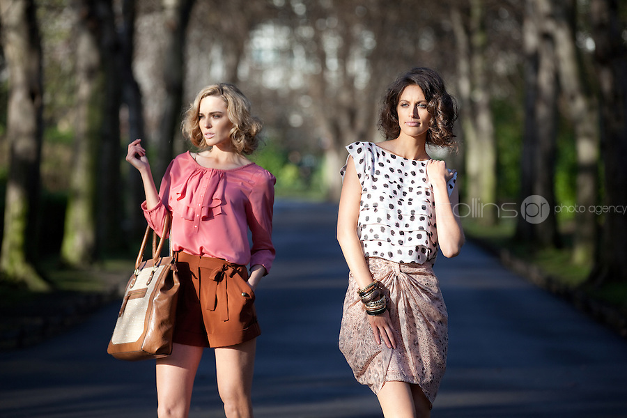 NO REPRO FEE. 1/2/2011. A|WEAR LAUNCHES SPRING 2011.  Sarah Morrissey and Isabelle Traber model a selection looks from A|wear's spring '11 collection at  St Stephens Green, Dublin. Sarah wears Ivy scoop neck ruffle blouse - EUR30,Copper pocket detail shorts - EUR30, Straw mix shopper - EUR35. Isabelle wears Pleat print top - EUR30,Draped leopard skirt - EUR35. The collection is available now instore and on www.awear.com from this week.  Picture James Horan/Collins Photos