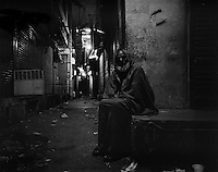 A night guard at the end of his shift in one of the main markets of old Lahore, Pakistan on Monday November 16, 2009.