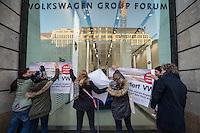 """Aktion der Kampagne """"VW Boykott"""" am Freitag den 6. Januar 2017 am Show Room der Volkswagen AG in Berlin.<br /> Aktivisten beklebten die Scheiben des VW-Volkswagen Group Forum in der Friedrichstrasse und Unter den Linden mit Aufklebern die zum Boykott von VW auf Grund des Abgasskandals aufrufen.<br /> Initiiert wurde die Kampagne vom Berliner Professor Peter Grottian.<br /> 7.1.2017, Berlin<br /> Copyright: Christian-Ditsch.de<br /> [Inhaltsveraendernde Manipulation des Fotos nur nach ausdruecklicher Genehmigung des Fotografen. Vereinbarungen ueber Abtretung von Persoenlichkeitsrechten/Model Release der abgebildeten Person/Personen liegen nicht vor. NO MODEL RELEASE! Nur fuer Redaktionelle Zwecke. Don't publish without copyright Christian-Ditsch.de, Veroeffentlichung nur mit Fotografennennung, sowie gegen Honorar, MwSt. und Beleg. Konto: I N G - D i B a, IBAN DE58500105175400192269, BIC INGDDEFFXXX, Kontakt: post@christian-ditsch.de<br /> Bei der Bearbeitung der Dateiinformationen darf die Urheberkennzeichnung in den EXIF- und  IPTC-Daten nicht entfernt werden, diese sind in digitalen Medien nach §95c UrhG rechtlich geschuetzt. Der Urhebervermerk wird gemaess §13 UrhG verlangt.]"""