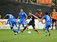 Chris Pontius (13) of D.C. United goes against Nana Attakora (23) of the San Jose Earthquakes.  D.C. United defeated the San Jose Earthquakes 1-0, at RFK Stadium, Saturday June 22 , 2013.