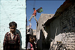 In the Islamabad slum called 'France Colony' - locals put up flags and banners prior to the February 18th elections