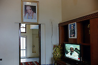 Ben Waled, Libya, March 23, 2011.In this image taken during an organized trip by the Libyan authorities, Khaddafi portraits hang in a hotel lobby.