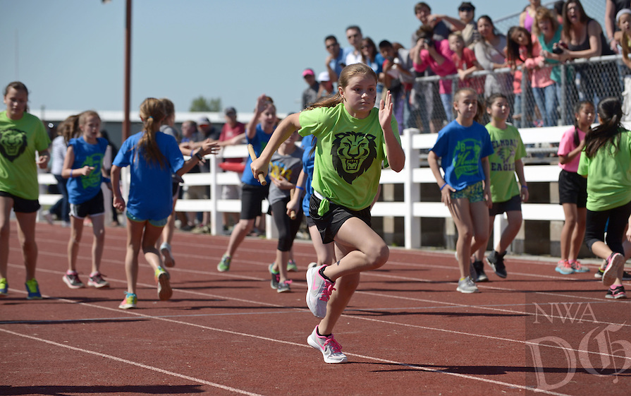 NWA Democrat-Gazette/BEN GOFF @NWABENGOFF<br /> Emma Breaux runs a leg for the Lee Elementary team in the girls 240 yard relay final on Saturday April 23, 2016 during the 41st Annual Springdale Kiwanis Little Olympics at the Roberts Track Complex at Southwest Junior High School in Springdale. The Lee Lions team won the event. Over 800 5th graders from Springdale schools competed in 10 track and field events.