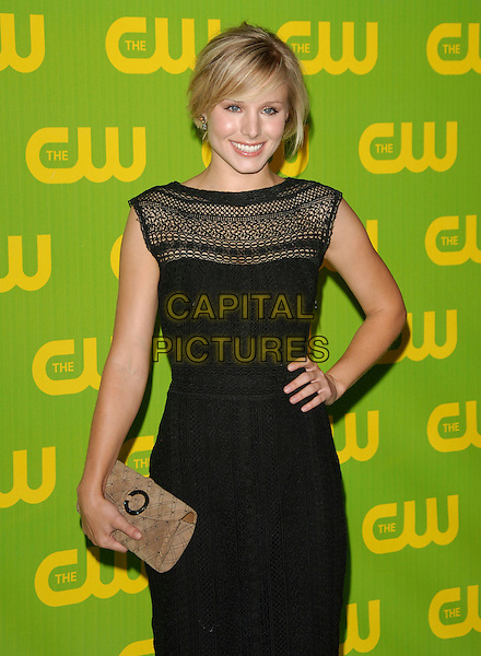 KRISTEN BELL.The CW Launch Party held at Warner Brothers' Studios in Burbank, California, USA..September 18th, 2006.Ref: DVS.half length black sleeveless dress hand on hip clutch purse brown.www.capitalpictures.com.sales@capitalpictures.com.©Debbie VanStory/Capital Pictures