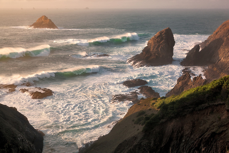 Sunset and waves at Port Orford Heads State Park, Oregon