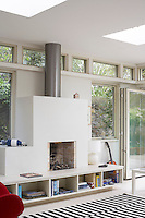 White wood burning fireplace with steel chimney and built in storage cubes below