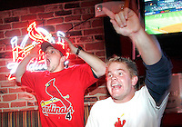 St. Louis Cardinal fans, Brad Siler, left, of Overland, and Sean Culleton, of Soulard, cheer at St. Louis Sports Zone in Shrewsbury during the sixth inning of the National League Championship Series game 7 against the New York Mets.