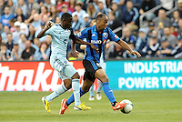 KANSAS CITY, KS - June 1, 2013:<br /> Patrice Bernier (8) midfield Montreal Impact  goes past Peterson Joseph (19) midfield Sporting KC.<br /> Montreal Impact defeated Sporting Kansas City 2-1 at Sporting Park.