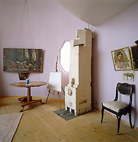 The sitting room is painted an unusual and subtle shade of pink