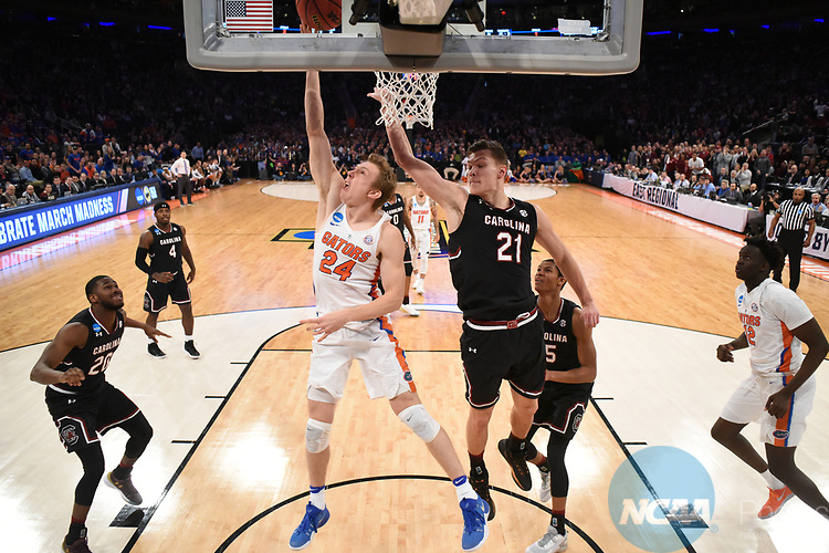 NEW YORK, NY - MARCH 26:  Canyon Barry #24 of the Florida Gators is guarded by Maik Kotsar #21 of the South Carolina Gamecocks during the 2017 NCAA Men's Basketball Tournament held at Madison Square Garden on March 26, 2017 in New York City. (Photo by Justin Tafoya/NCAA Photos via Getty Images)