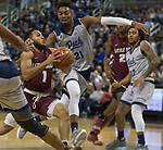 Little Rock guard Markquis Nowell (1) drives the lane against Nevada in the first half of an NCAA college basketball game in Reno, Nev., Friday, Nov. 16, 2018. (AP Photo/Tom R. Smedes)