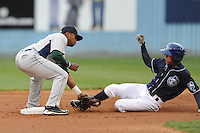 Lexington Legends Delino DeShields Jr. #2 applies the tag to a sliding Rafael Ortega during a game against  the Lexington Legends at McCormick Field in Asheville,  North Carolina;  April 16, 2011. Lexington defeated Aheville 13-7.  Photo By Tony Farlow/Four Seam Images