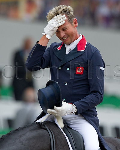 18.08.2011 British dressage rider Carl Hester gestures during the team competition of the FEI European Dressage Championships in Rotterdam.
