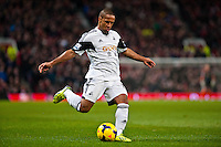 Saturday 11 January 2014 Pictured: Wayne Routledge crosses the ball<br /> Re: Barclays Premier League Manchester Utd v Swansea City FC  at Old Trafford, Manchester