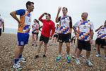 © Joel Goodman - 07973 332324 . 23/09/2013 . Brighton , UK . Alan Milburn , Eddie Izzard and Alastair Campbell join runners along Brighton Beach to raise awareness for Alcohol Concern . Day 2 of the Labour Party 's annual conference in Brighton . Photo credit : Joel Goodman