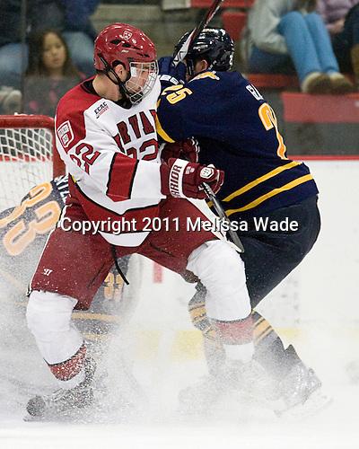 David Valek (Harvard - 22), Mike Glaicar (Quinnipiac - 25) - The Harvard University Crimson and Quinnipiac University Bobcats played to a 2-2 tie on Saturday, November 5, 2011, at Bright Hockey Center in Cambridge, Massachusetts.