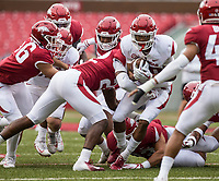 Hawgs Illustrated/BEN GOFF <br /> Jordon Curtis, Arkansas running back, takes a hit from Deon Edwards, Arkansas linebacker, in the first quarter Saturday, April 6, 2019, during the Arkansas Red-White game at Reynolds Razorback Stadium.