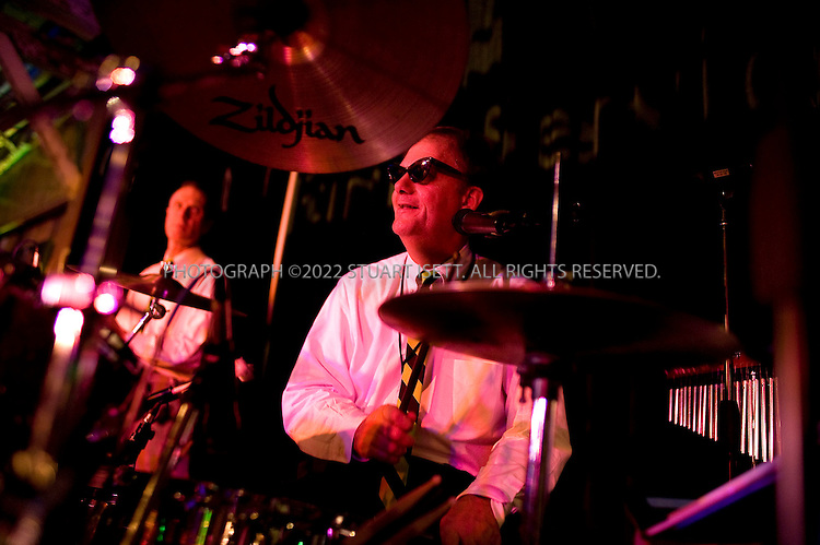 10/24/2008--Seattle, WA, USA..The Frustrations, a band of CEOs and executives from Washington State, play at a charity event to raise funds for Family Services. Here Michael Kelly ? Marsh Inc...©2008 Stuart Isett. All rights reserved.