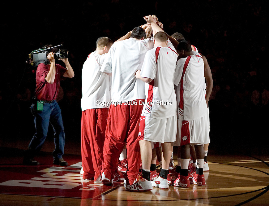 MADISON, WI - DECEMBER 13: The Wisconsin Badgers huddle prior to the game against the UW-Milwaukee Panthers at the Kohl Center on December 13, 2006 in Madison, Wisconsin. The Badgers beat the Panthers 68-49. (Photo by David Stluka)