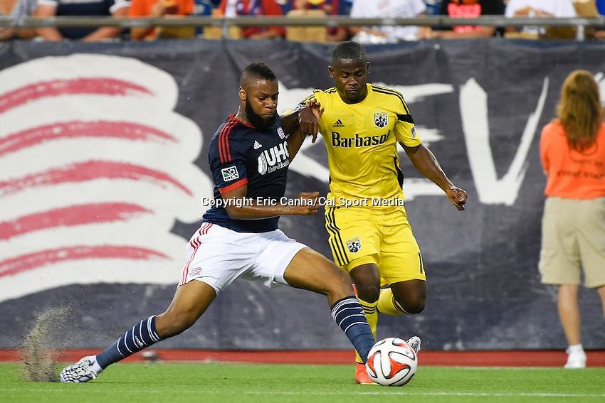 July 26, 2014 - Foxborough, Massachusetts, U.S. - Columbus Crew defender Waylon Francis (14) works at getting the ball from New England Revolution defender Andrew Farrell (2) during the MLS game between the Columbus Crew and the New England Revolution held at Gillette Stadium in Foxborough Massachusetts.  Eric Canha/CSM