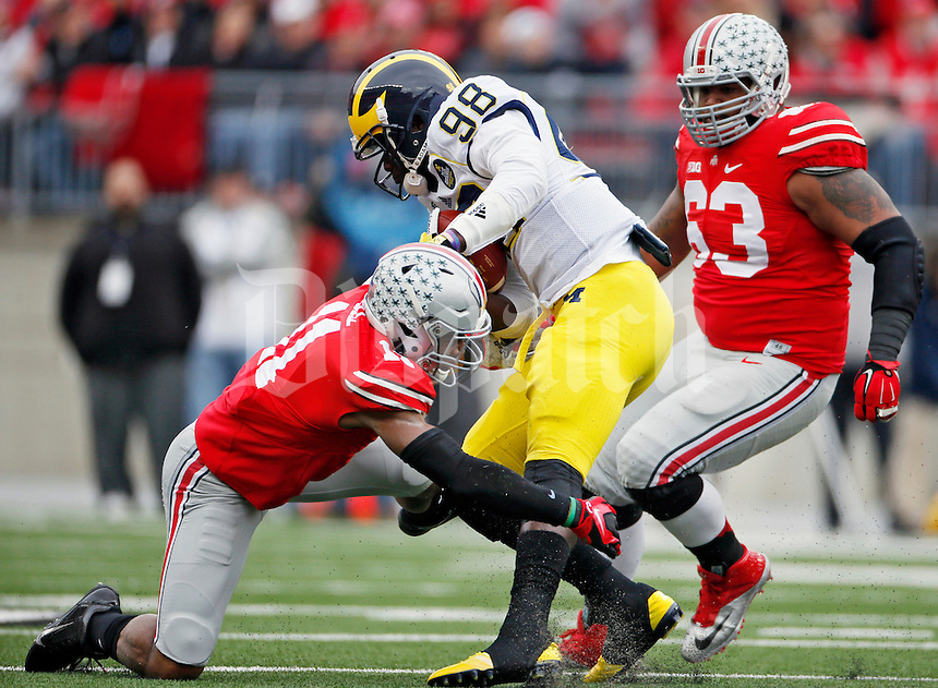 Ohio State Buckeyes defensive back Vonn Bell (11) and Ohio State Buckeyes defensive tackle Michael Bennett (63) against Michigan Wolverines at Ohio Stadium in Columbus, Ohio on November 29, 2014.  (Dispatch photo by Kyle Robertson)