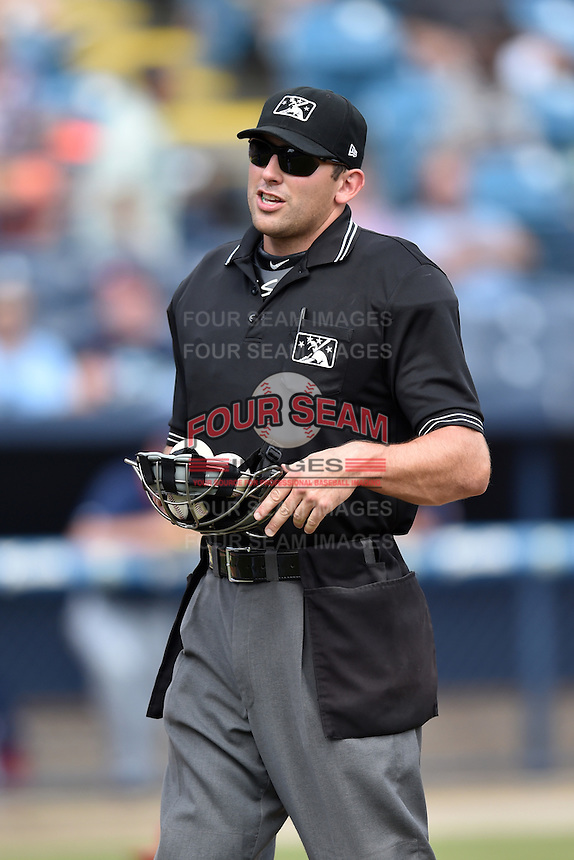 Home plate umpire Jason Johnson during a game between the Hagerstown Suns and the Asheville Tourists at McCormick Field on September 5, 2016 in Asheville, North Carolina. The Suns defeated the Tourists 9-5. (Tony Farlow/Four Seam Images)