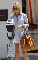 Ali Larter wire a trendy striped button up shirt with short shorts and a chunky necklace while out and about with a friend in Beverly Hills. Los Angeles, California on 24.05.2012..Credit: Correa/face to face.. Mediapunchinc *** network and online use only no print magazine**