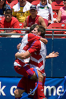 FC Dallas foward Kenny Cooper (33) celebrates his goal with teammate Arturo Alvarez (12).  Chicago Fire vs FC Dallas at Pizza Hut Park Frisco, Texas June-15-2008.  FC Dallas 1, Chicago 0.