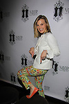 Gina Tognoni shows off one of shoes from her new line of shoes starting in June - Marcia Tovsky throws her annual party on May 9, 2013 with actors from One Life To Live and As The World for a get together at Noir in New York City, New York. (Photo by Sue Coflin/Max Photos)