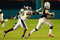 29 November 2008:  FIU defensive end Kambriel Willis (55) pursues Florida Atlantic quarterback Rusty Smith (11) late in the FAU 57-50 overtime victory over FIU in the annual Shula Bowl at Dolphin Stadium in Miami, Florida.