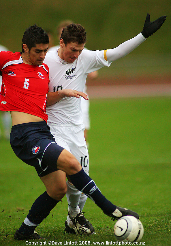 Daniel Ellensohn fights Chile's Sebastien Mendez for the ball during the international football friendly between the NZ Oly-Whites and Chile Under-23 at Newtown Park, Wellington, New Zealand on Wednesday 3 July 2008. Photo: Dave Lintott / lintottphoto.co.nz