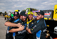 Sep 29, 2019; Madison, IL, USA; NHRA funny car driver Shawn Langdon celebrates with crew members after winning the Midwest Nationals at World Wide Technology Raceway. Mandatory Credit: Mark J. Rebilas-USA TODAY Sports