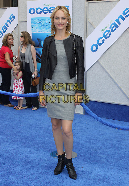 "AMBER VALLETTA .Arrivals - Disneynature's Premiere Of ""Oceans"" held At El Caitan Theatre,  Hollywood, California, USA, .17th April 2010..full length black leather jacket grey gray dress  smiling ankle boots wedges wedge.CAP/ADM/KB.©Kevan Brooks/AdMedia/Capital Pictures"