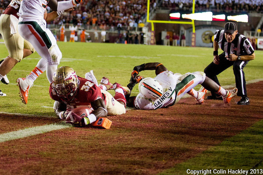 TALLAHASSEE, FL 11/2/13-FSU-MIAMI110213CH-Florida State's James Wilder, Jr. lands in the endzone after Miami's Jimmy Gaines couldd not stop him during second half action Saturday at Doak Campbell Stadium in Tallahassee. The Seminoles beat the Hurricanes 41-14.<br /> COLIN HACKLEY PHOTO