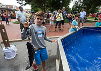 NWA Democrat-Gazette/BEN GOFF @NWABENGOFF<br /> Campbell Laws, 10, of Rogers holds up the catfish he caught at the Kid Fish pond Friday, July 5, 2019, during First Friday on the Bentonville Square. The theme for July was 'Great Outdoors.' Kid Fish brought their tank stocked with catfish to the square in partnership with Nunnally Chevrolet. They have set up the tank at the Bentonville dealership in the past.