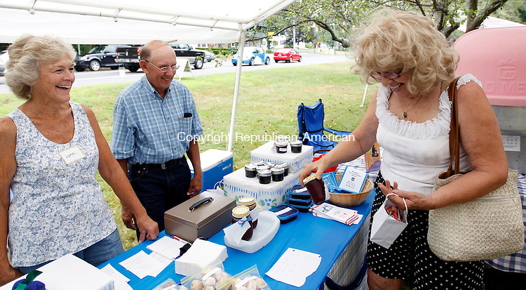 "Woodbury, CT- 25, July 2011-072511CM05 FOR COUNTRY LIFE!!!!  Lynne and Dave Brencher, of Bethlehem talk with Alice Ajello, (right) of Southbury who was looking to buy blueberry sauce, during the first Blueberry Festival on the north green Sunday afternoon in Woodbury.  The event, sponsored by the Woodbury United Methodist Church, featured games, baked goods, lunch, a pie eating contest and live music. ""The volunteers and support from the community has been outstanding.  We truly appreciate it."" said Jo Ann Behlman Chairperson for the event.   Christopher Massa Republican-American"