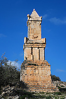 Low angle view of the Mausoleum of Ateban, also known as the Lybico-Punic Mausoleum, 2nd century B.C., in Dougga, Tunisia, pictured on January 31, 2008, in the afternoon. Dougga has been occupied since the 2nd Millennium BC, well before the Phoenicians arrived in Tunisia. It was ruled by Carthage from the 4th century BC, then by Numidians, who called it Thugga and finally taken over by the Romans in the 2nd century. Situated in the north of Tunisia, the site became a UNESCO World Heritage Site in 1997. The Mausoleum of Numidian Prince Ateban was built in the 3rd century. It collapsed when a British Consul removed a stone at the base and was rebuilt in the 20th century. It is the only structure belonging to the Numidian/Punic period. It even holds the name of the architect, Abarish. Picture by Manuel Cohen.