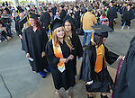 Graduates wait to get their diplomas during the 2015 Western Nevada College Commencement held at the Pony Express Pavilion in Carson City, Nev., on Monday, May 18, 2015.<br /> Photo by Tim Dunn