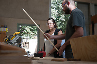 Occidental College Professor Mary Beth Heffernan helps students work on their projects in Sculpture I at the Pamela M. Mullin and Peter W. Mullin Family Studio and Art Gallery, Oct. 1, 2009. (Photo by Marc Campos, Occidental College Photographer)