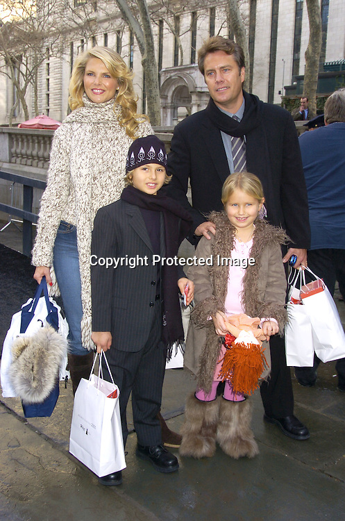 Christie Brinkley and Peter Cook and son Jack and Sailor ..at The Heart Truth's Red Dress Collection at the Olympus..Fashion Week in Bryant Park on February 4, 2005...Photo by Robin Platzer, Twin Images
