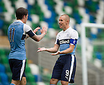 Kenny Miller celebrates the first goal with Josh Windass