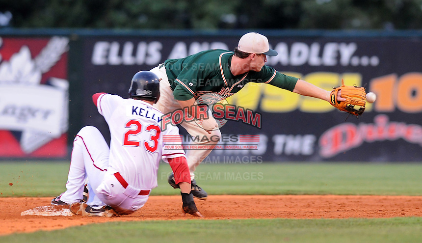 August 13, 2009: Shortstop Paul Gran (15) of the Greensboro Grasshoppers stretches but can't quite reach the throw as Casey Kelly (23) of the Greenville Drive slides in safely during a game at Fluor Field at the West End in Greenville, S.C. Photo by: Tom Priddy/Four Seam Images
