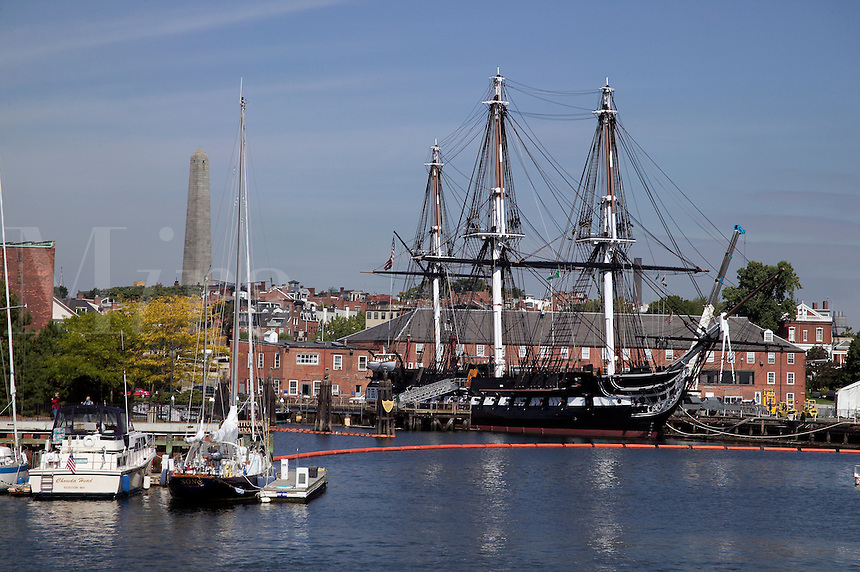 USS Constitution and Bunker Hill Monument on Breeds Hill view from MBTA ferryboat in Boston Harbor, Boston, M