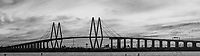 This is the Fred Hartman Bridge panorama in black and white outside of Houston which runs across the ship channel between Baytown and La Porte Texas. This is a very long bridge which runs about 2.6 miles.  On this day we had been in the area and decided to go see if we could capture it and boy did we get an incredible sunset. This bridge replaced the Baytown tunnel which went under the water because they need it to be deeper,  As a child we would drive through the tunnel and I was alway scare it would collapse on us. Watermark will not appear on image